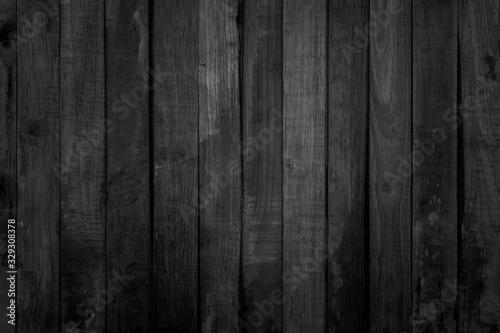 Fototapeta Grunge dark wood plank texture background. Vintage black wooden board wall antique cracking old style background objects for furniture design. Painted weathered peeling table wood hardwood decoration. obraz na płótnie