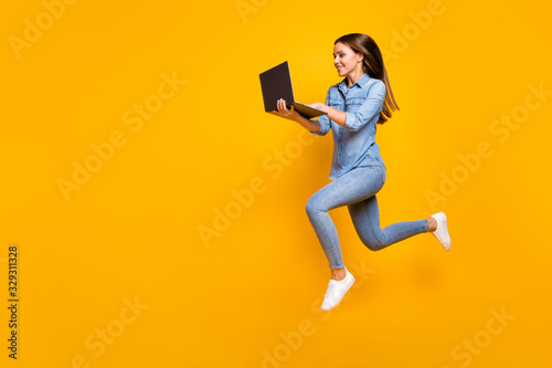 Fototapeta Full size profile photo of beautiful business lady jump high hold notebook hands