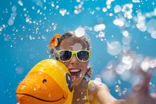 Happy Child Having Fun On Summer Vacation