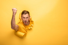 Angry Handsome Man In Yellow O...
