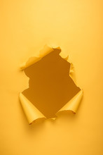 Torn Hole In Yellow Paper Text...