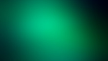 Abstract Green Blurred Background With Dark Edges.