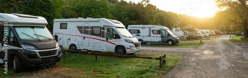 Obraz Camper vans in a camping park - fototapety do salonu