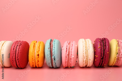 Colorful french macaroons on pink background