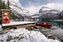 Scenery Of Lake O'hara With Red Canoe In Wooden Dock On Winter At Yoho National Park