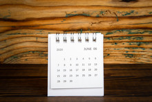 2020 June. White Paper Calendar On A Wooden Table