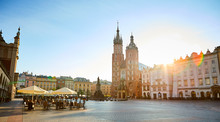 Krakow's Main Square (Rynek Glowny) With St. Mary's Basilica Church And Adam Mickiewicz Monument Located At Center Of The Old Town District In Lesser, Poland