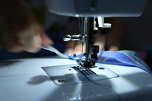 A Tailor Is Sewing Clothes Wit...
