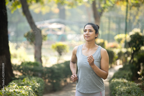 Leinwand Poster Fit sportswoman morning jogging at park outdoor