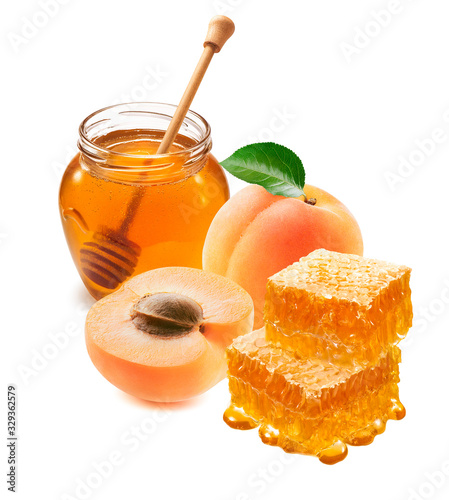 Apricots, honey jar with a dipper and honeycomb isolated on white background Canvas Print