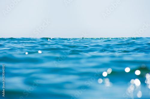 Lights on sea background. Waves. Canvas Print