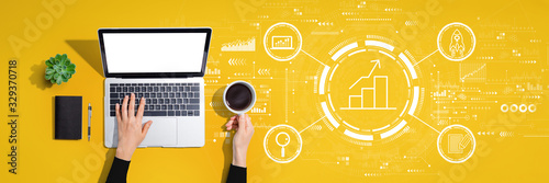 Business growth analysis with person using a laptop computer Wallpaper Mural