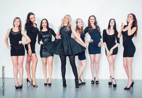 Fototapeta Many diverse women in line, wearing fancy little black dresses, party makeup, vice squad concept lifestyle obraz