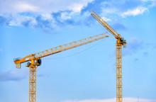 Construction Cranes Over Blue ...