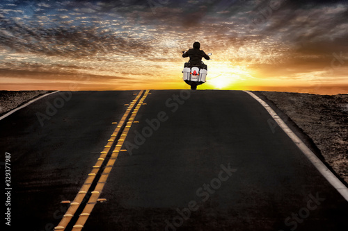 Motorcycle rider on street riding toward sunset sky Tapéta, Fotótapéta