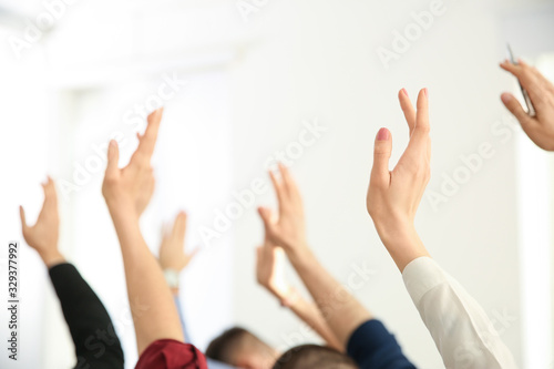 People raising hands to ask questions at business training indoors, closeup Canvas Print