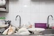 Leinwanddruck Bild - Metal sink full of dirty dishes, crockery, tableware