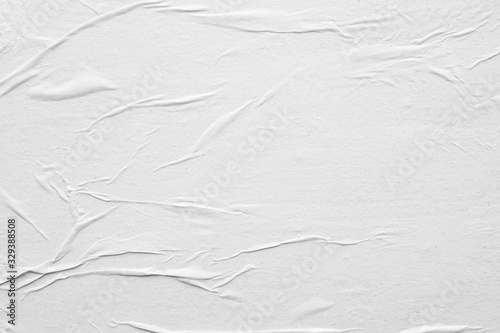 Fototapeta Blank white crumpled and creased paper poster texture background obraz