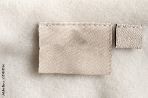 Obraz laundry care clothing label on fabric texture - fototapety do salonu