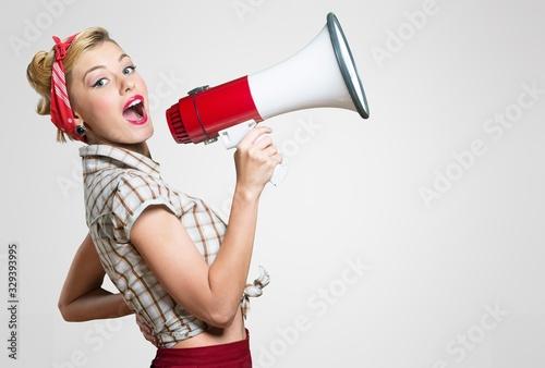 Fotografía Beautiful woman holding megaphone and screams