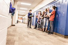 Students Hanging Out In The Hallway Between Classes, Discussing School. Red Lodge, Montana, USA