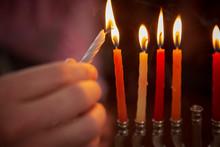 Close-up Of Boy Burning Candle...