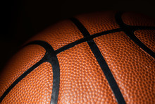 A Close-up Of A Leather Basketball On Black