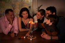 Family Looking At Boy Burning ...