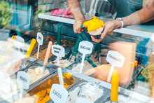 Woman Having Ice Cream In An Italian Ice Cream Shop