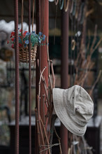 Old Forgotten Hat On An Iron Fence In The Rain