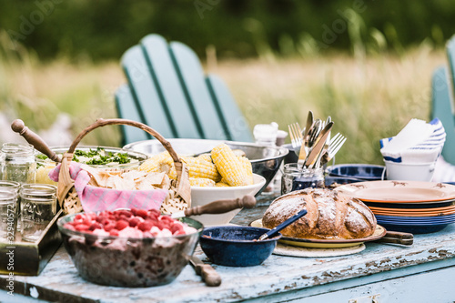 Picnic table set with loads of great food in the outdoors. Bridger, Montana, USA - 329405721