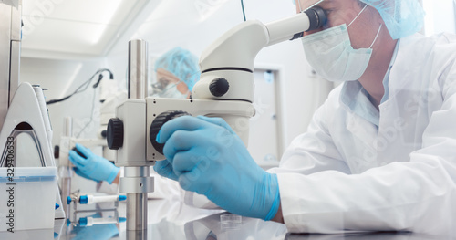Lab technicians of scientists working on developing a vaccine Canvas Print