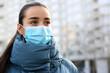 Leinwandbild Motiv Woman wearing disposable mask outdoors. Dangerous virus