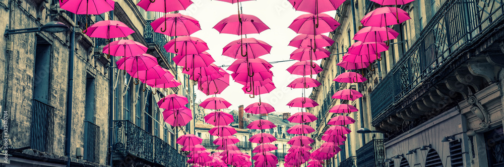 pink umbrellas in a street