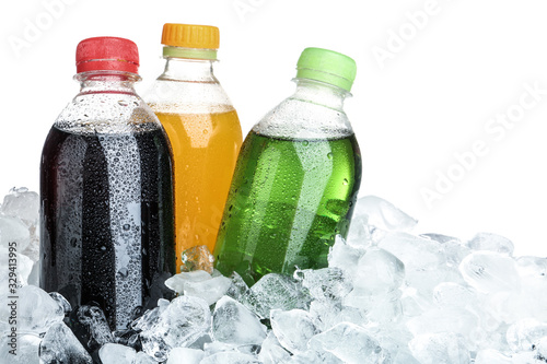 Ice cubes and different soda drinks on white background Wallpaper Mural
