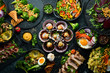 Food: meat dishes, vegetables and seafood on black stone background. Top view. Free space for text.