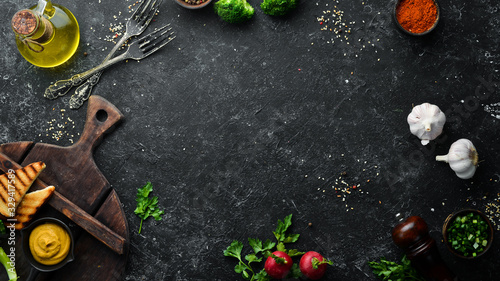 Fototapeta Black stone banner of food, vegetables and spices. Background of cooking. obraz