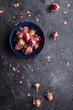Leinwanddruck Bild Dried pink rose buds on dark background