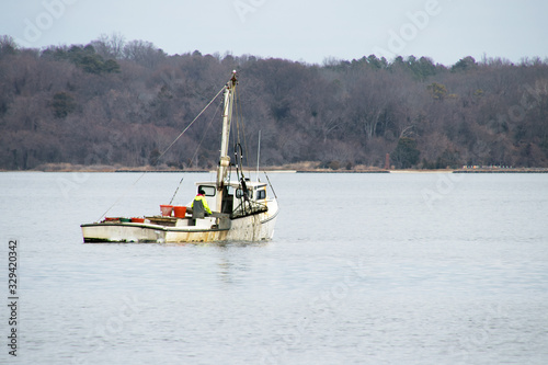 a commercial oyster boat dredging for oysters in the chesapeake bay Tapéta, Fotótapéta