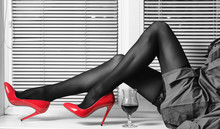 Female Legs In Red High-heeled...