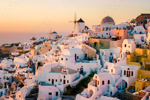 Fototapeta Santorini Oia village during sunset whit luxury hotels and whitewashed buildings in Santorini Island a luxury vacation destination in Greece obraz