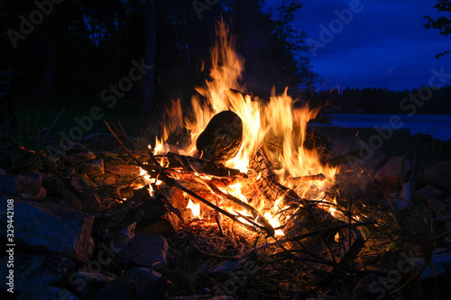 Bonfire in front of a lake at night