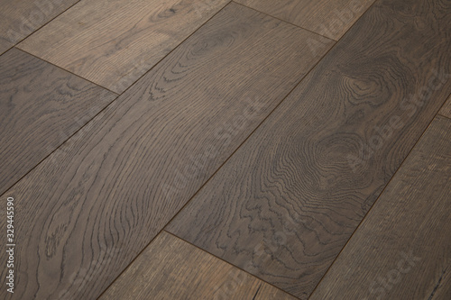 Fototapeta Wooden natural texture. New parquet blank. Wooden laminate floor boards background image. Home decor. obraz