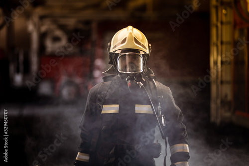 firefighter portrait wearing full equipment with oxigen mask Canvas Print