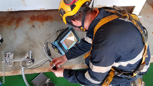 NDT Technician making phased array tests on steel Wallpaper Mural