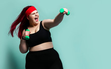 Fitness Spring Diet Weight Loss Concept. Lucky Plus-size Girl Overweight Woman Dieting Working Out With Green Weights Dumbbells