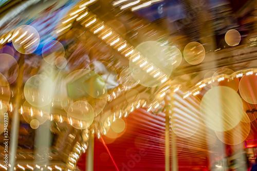 Valokuvatapetti Motion blur of merry-go-round carousel with bokeh