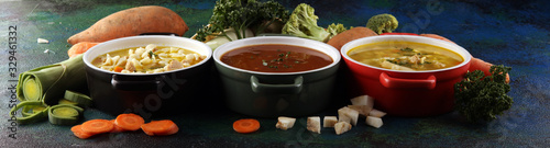 Fototapeta Set of soups from worldwide cuisines, healthy food. Broth with noodles, beef soup and broth with marrow dumplings. All soups with healthy vegetables on table obraz