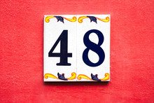 Number 48, Forty-eight, Decorative Tiles On A Red Wall.