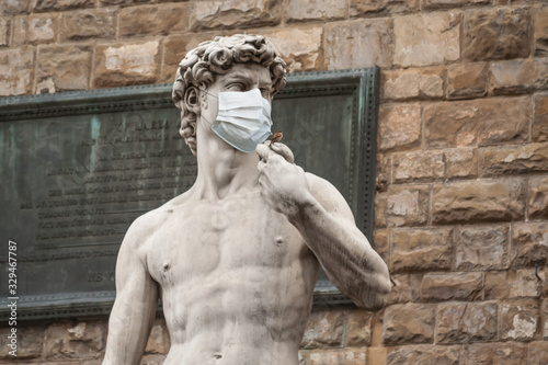 The Statue Of David in the Piazza della Signoria In Italy Wearing a Protective F Canvas Print